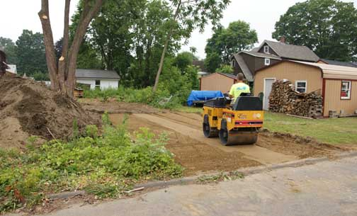 Compacting driveway