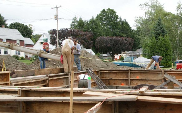 Pouring concrete into house stemwall
