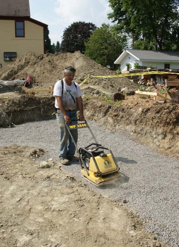 Compacting the crushed stone