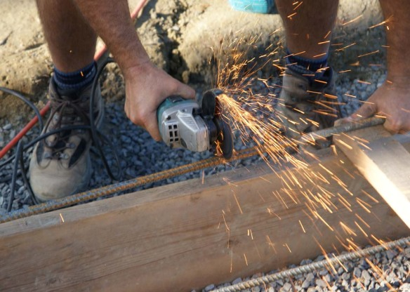 Thom cutting rebar with an angle grinder
