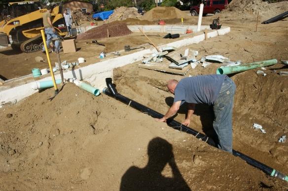 working-on-sub-slab-rough-in-plumbing