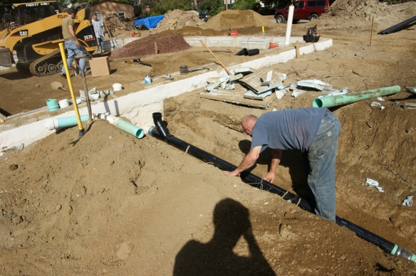 working-on-sub-slab-rough-in-plumbing
