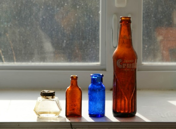 Old glass jars that we found. Including a 1950's Orange Crush Soda Pop, a jar that has an intact metal lid with original? liquid (it says Waterman's on the bottom) and Bromo-seltzer made in Baltimore, MD by the Emerson Drug Co.