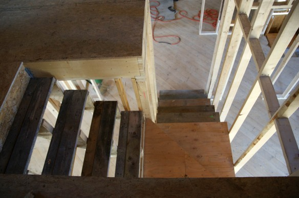 Looking down at the stairwell to the third floor. Right angle stairwell with winder