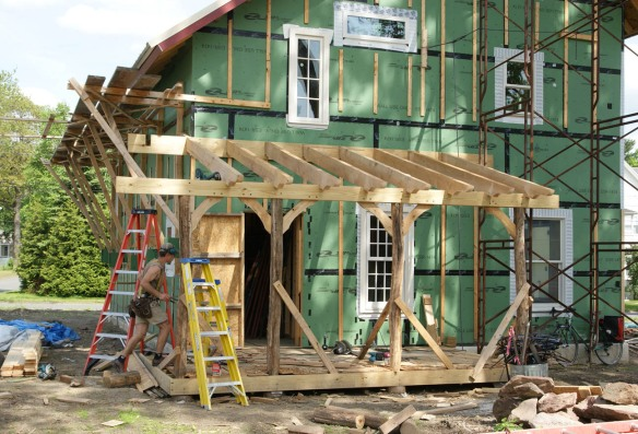 Artistic porch with rough sawn beams and posts in the round