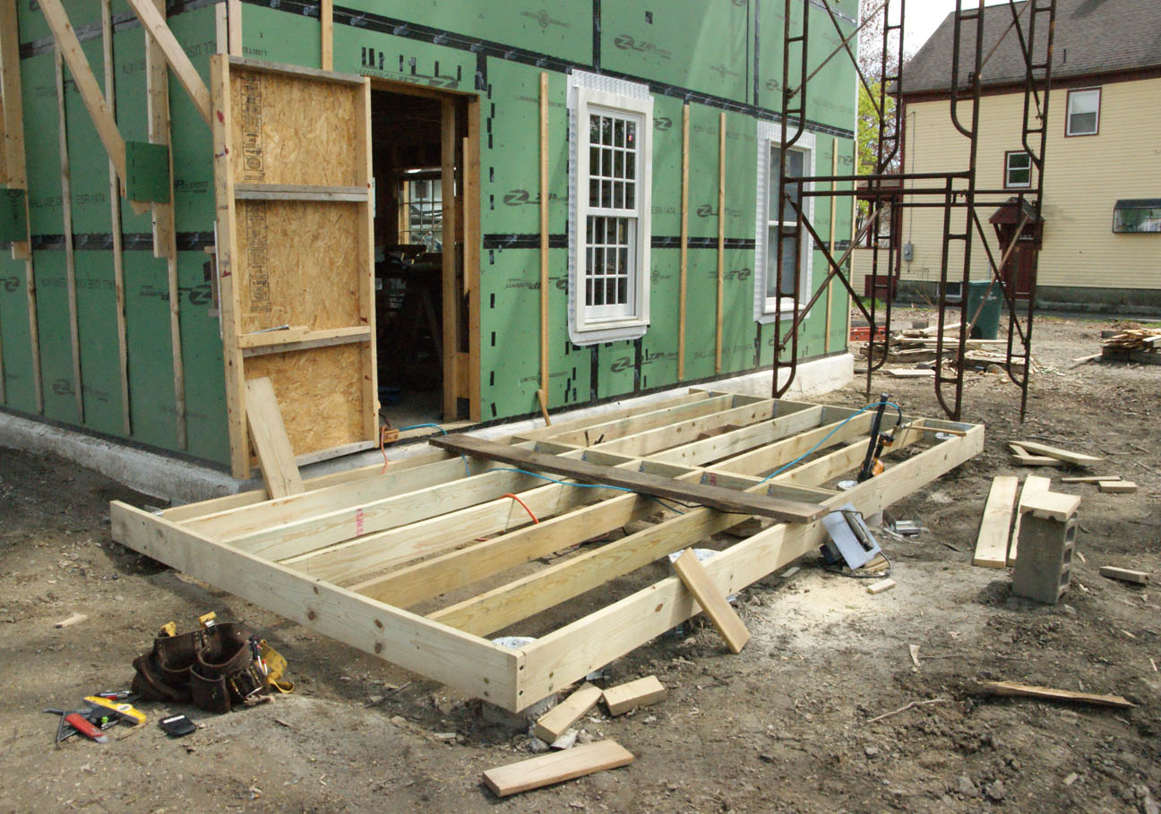 Porch progress design construction of spartan hannah for Balcony joists