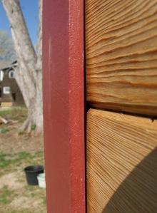 Siding behind trim detail