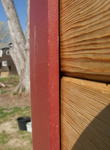 Siding behind trim detail
