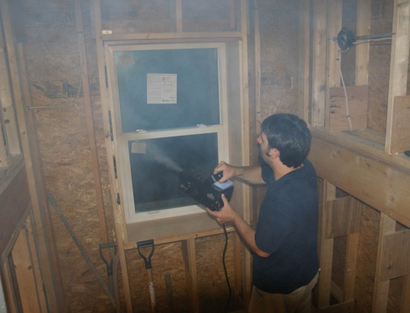 Matt using the fog machine during the blower door test
