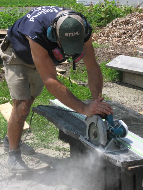 Cutting granite stone threshold - dusty