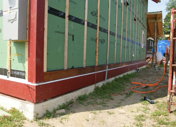 First course of siding goes on!
