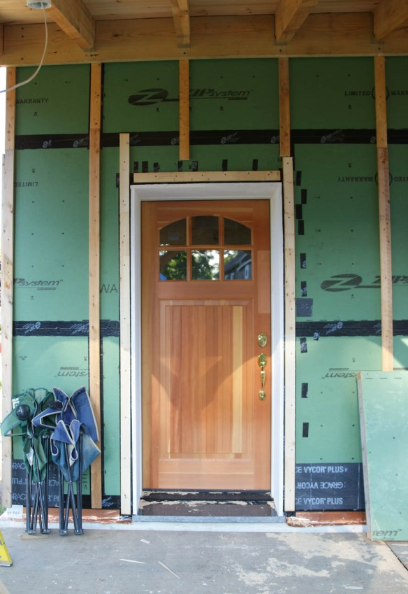 simpson bungalow solid fir door with brass thumb latch