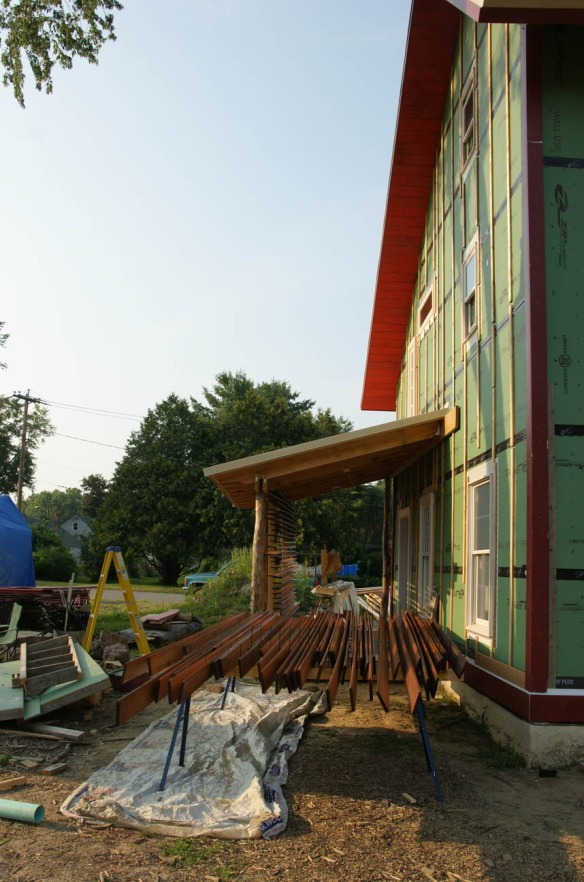 Freshly stained red cedar siding on our drying rack