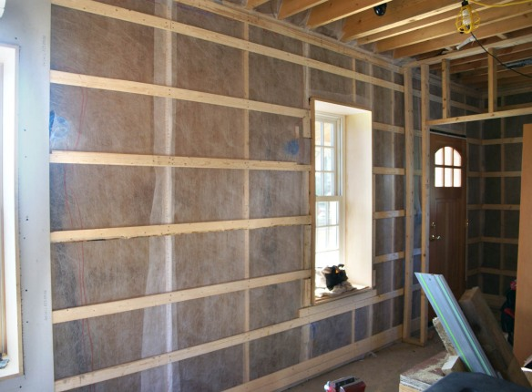 Netting and strapping first floor west wall