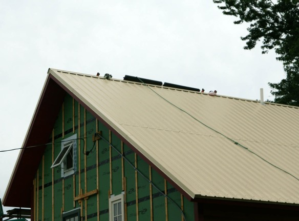 Solar hot water panels peaking over the roof