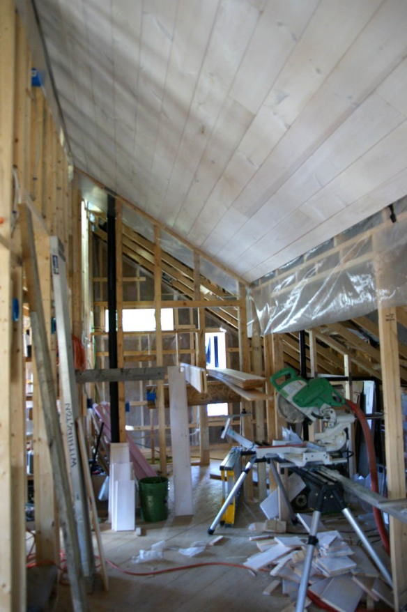 Tongue and groove knotty pine boards used for ceiling