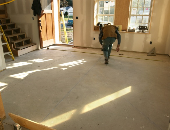 Laying out the chalk lines for the granite counter top scrap floor