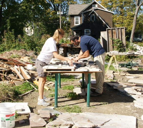 James and Lilly designing 2 foot square segments for the granite counter-top scrap floor