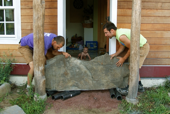 Stoop rock being moved into place