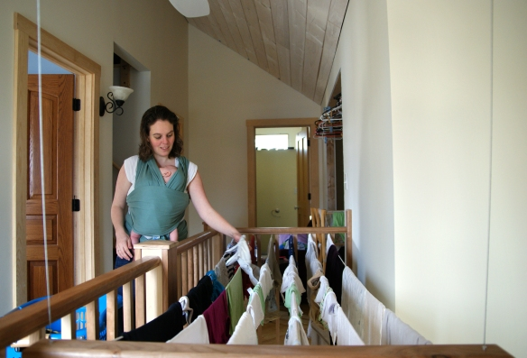 Hannah hanging clothes on indoor clothes line