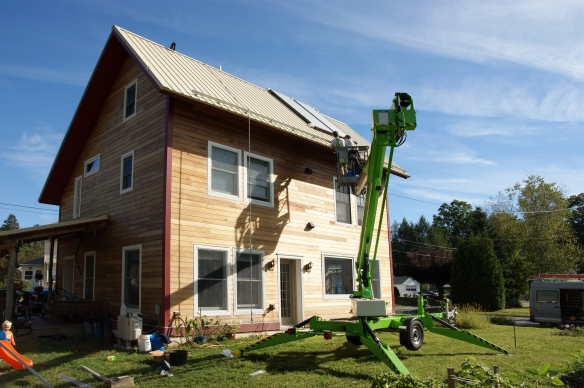 Using a lift to install rails for solar photovoltaic PV