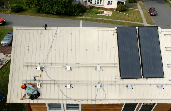 Sparta installing solar PV electric photovoltaic on roof